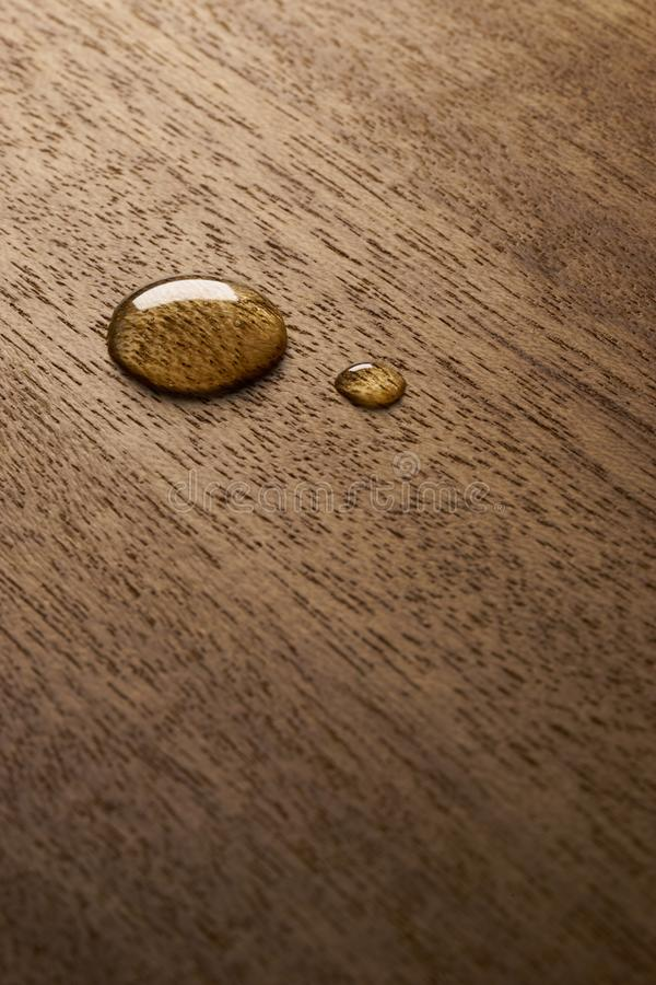 Water droplets on a wooden surface. Water drop on a wooden surface backgtound texture stock images
