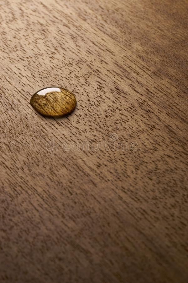 Water droplets on a wooden surface. Water drop on a wooden surface backgtound texture royalty free stock photography