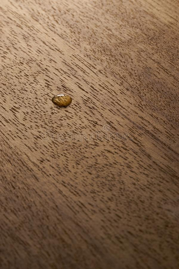 Water droplets on a wooden surface. Water drop on a wooden surface backgtound texture stock photo