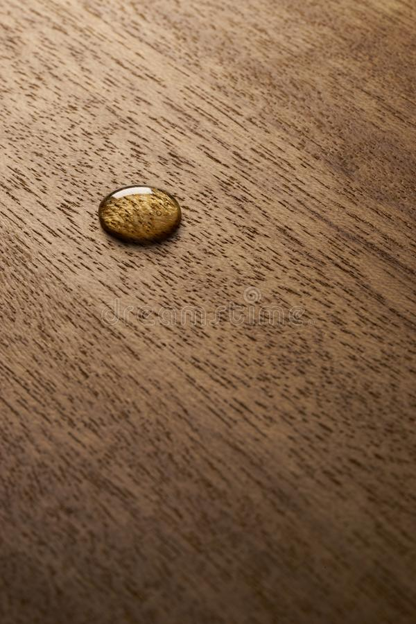 Water droplets on a wooden surface. Water drop on a wooden surface backgtound texture stock photos