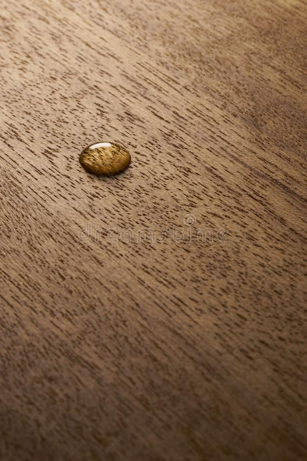 Water droplets on a wooden surface. Water drop on a wooden surface backgtound texture stock photography