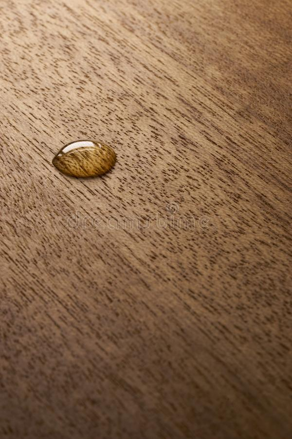 Water droplets on a wooden surface. Water drop on a wooden surface backgtound texture royalty free stock images