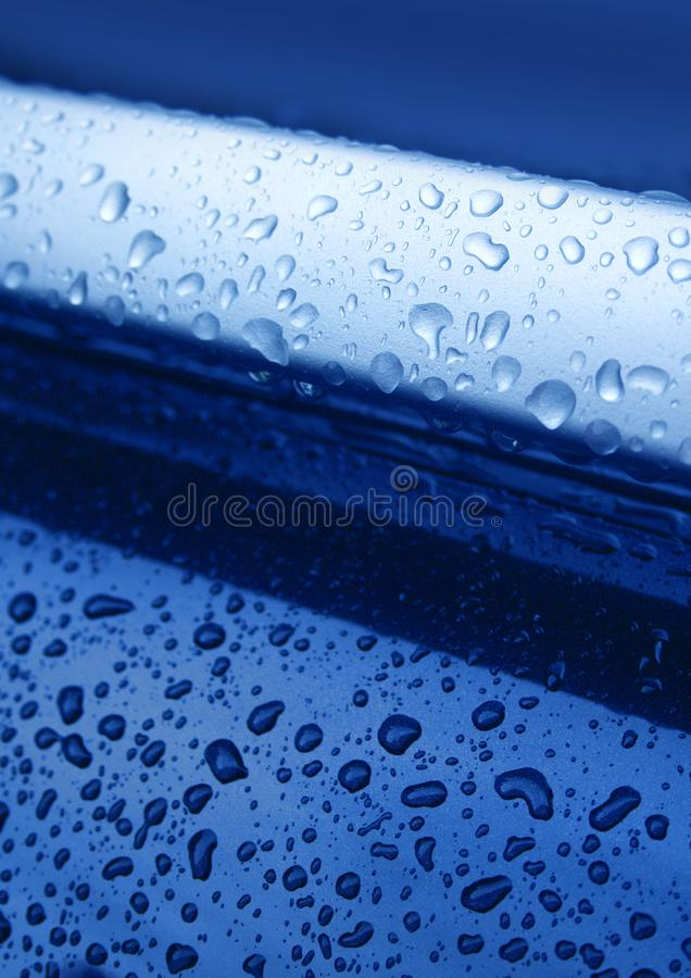 Water drops on blue metal stock images