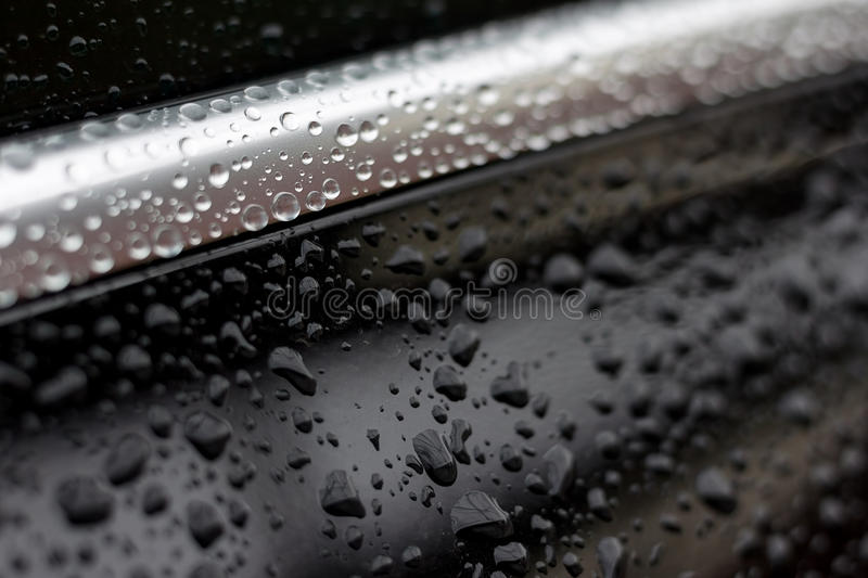 Water drops. On car hood royalty free stock photo