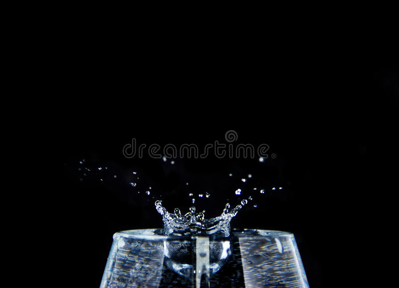 Water drops into a class royalty free stock photography
