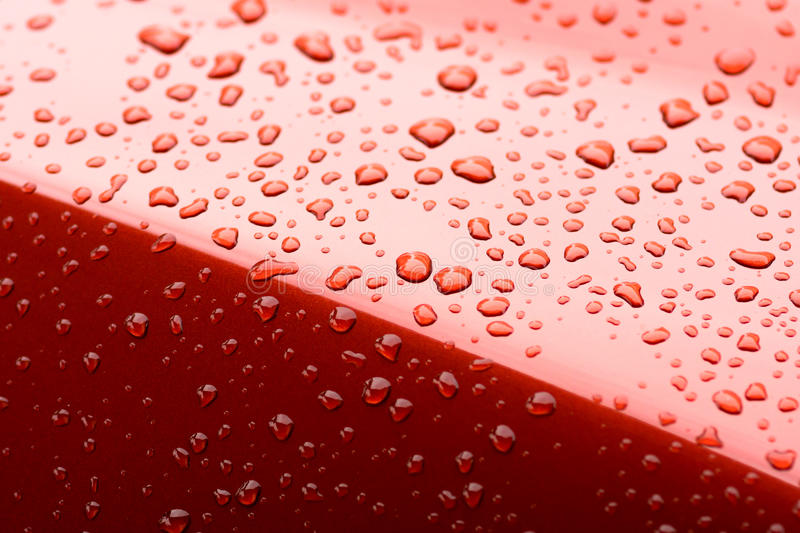 Water drops. Collect on top of metal red car surface stock photography
