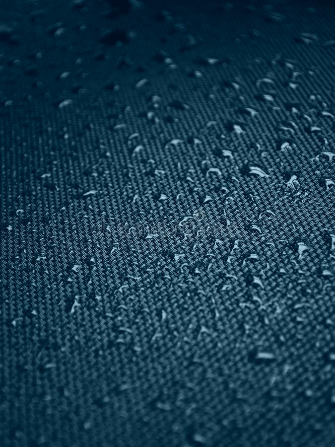 Water drops on fabric texture stock images
