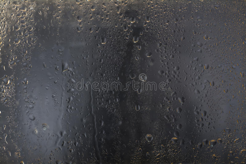 Water drops on glass royalty free stock photography