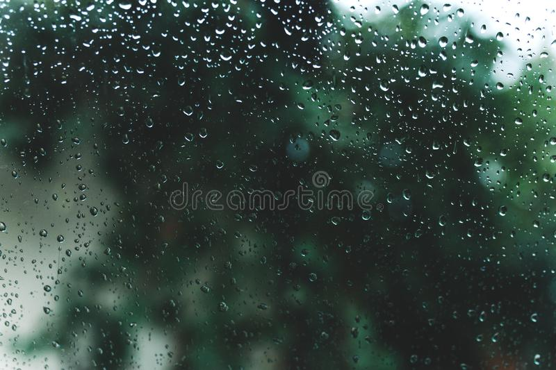 Water drops on glass. wet home windows. autumn cold royalty free stock photography