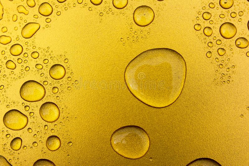 Water drops on gold background or texture royalty free stock photography