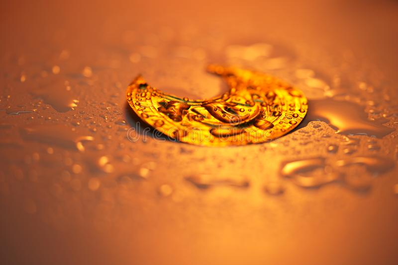 Water drops on the Gold stock photography