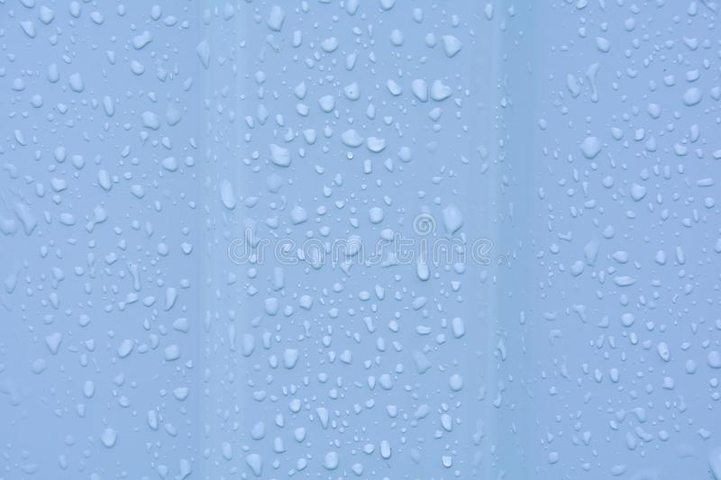 Water drops after rain on a corrugated profile roofing sheet. Abstract background image texture stock photos