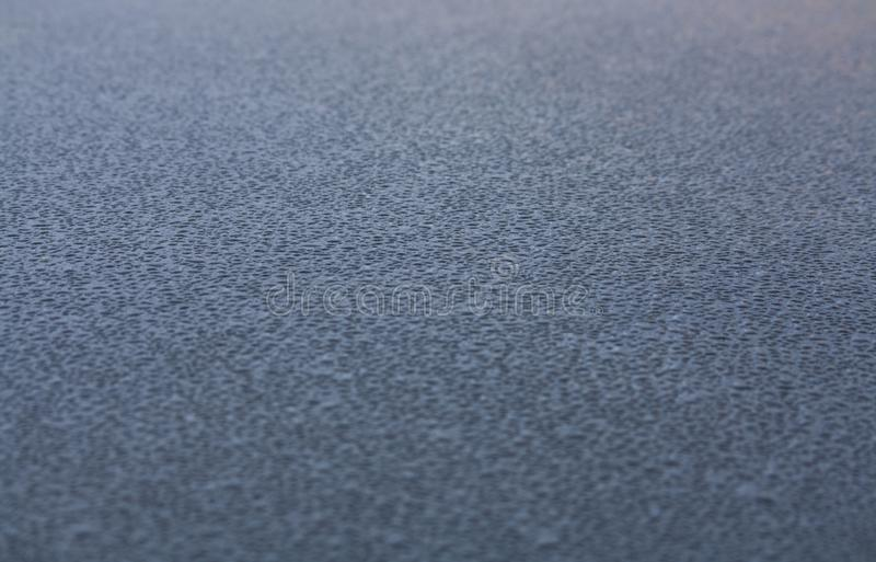 Water drops on the roof of a car royalty free stock image