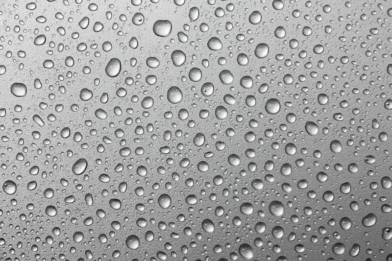 Water drops on a silver background. water drops on metal silver background. Surface stock images