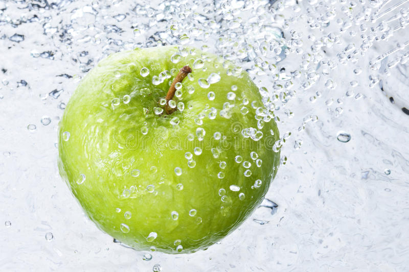 Water Drops Spray Apple royalty free stock image