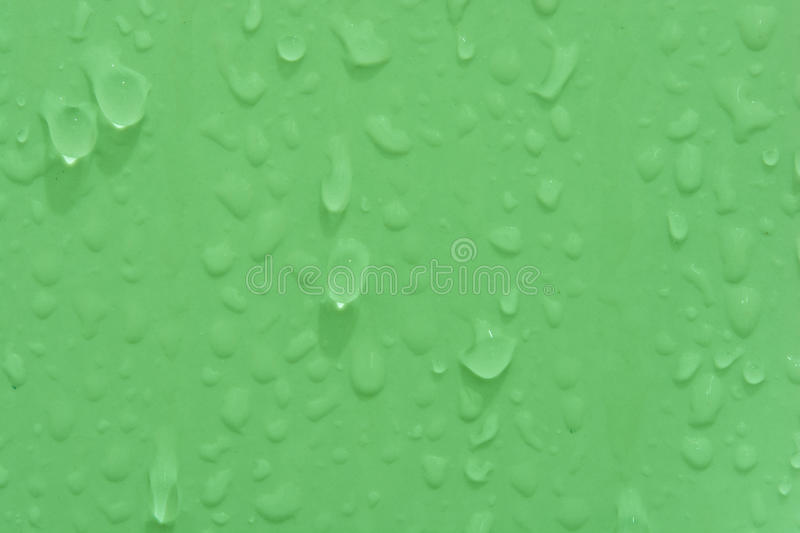Water drops texture. Green water drops texture for your a background stock image