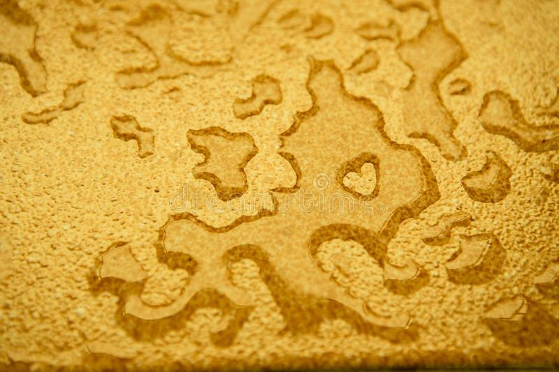Water drops on Yellow surface. Texture background royalty free stock image