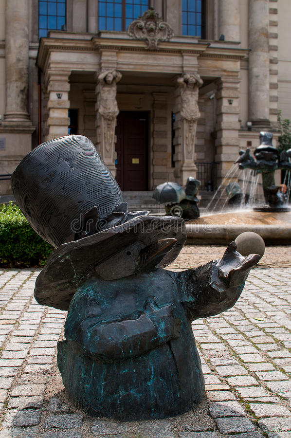 Water Dwarfs, Wroclaw. Symbol of Wroclaw, brass dwarf. There are more than 230 in the city and still they come! Water Dwarfs: dropping boats, Feeding Birds stock photo