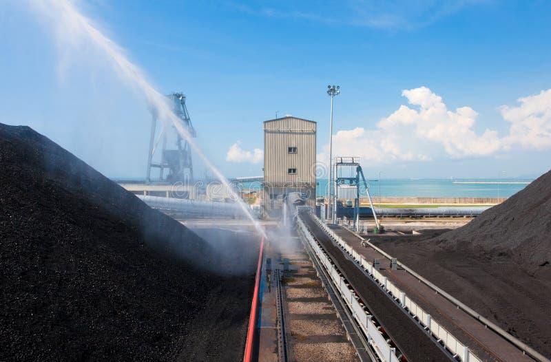 Water electric pump spraying water to reduce heati royalty free stock photos