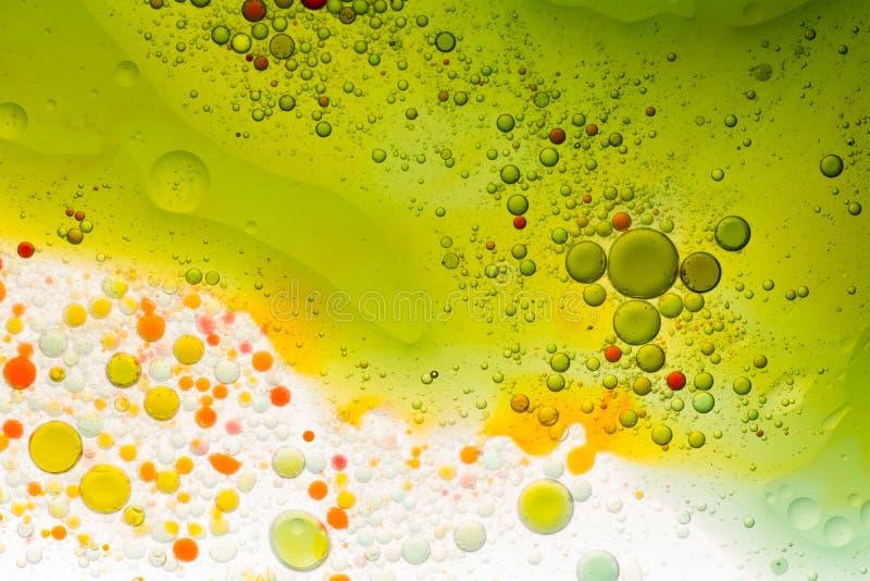 Water en oliebellenachtergrond stock afbeelding
