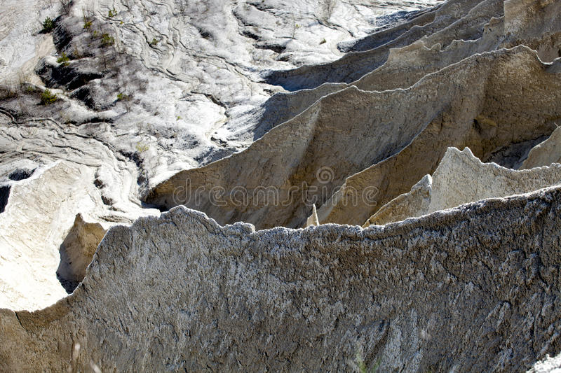 Water eroded large mining Spoil tip hill. Sharp unusual water eroded terrain of large mining Spoil tip hill stock photos