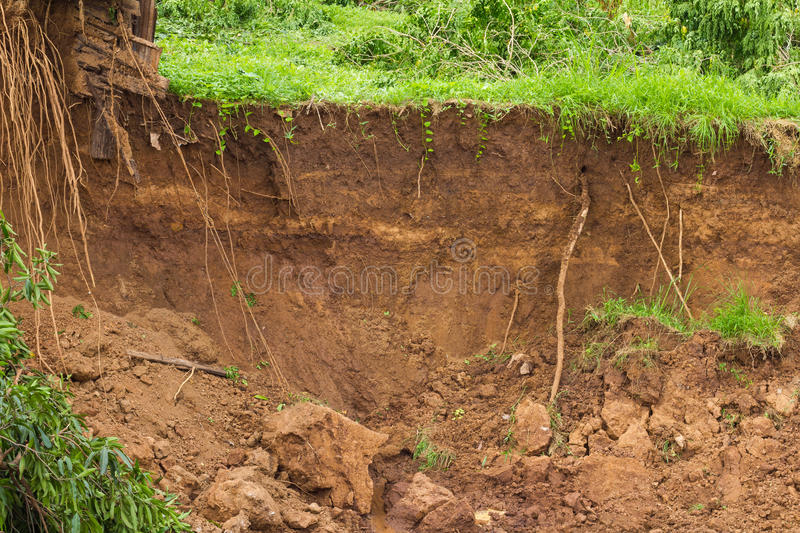 Water erosion, landslides. Soil slides down the coast collapsed because of the water flowing in the river eroded a long time stock photos