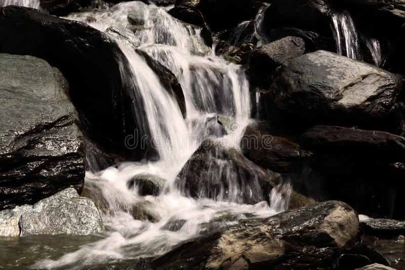 Water fall. Beautiful pic of water flowing through hard rocks stock photo