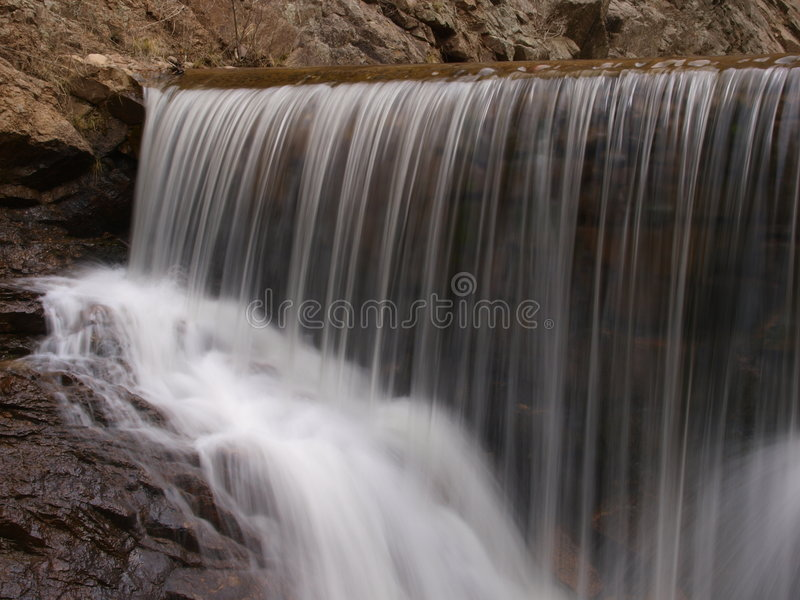 Water Fall. Color image of a cascading water fall stock photo