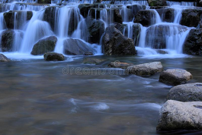 Water Fall. With beautiful white water flowing between rocks formation royalty free stock image