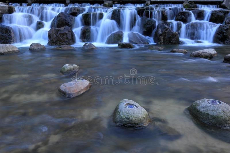 Water Fall. With beautiful white water flowing between rocks formation stock photo