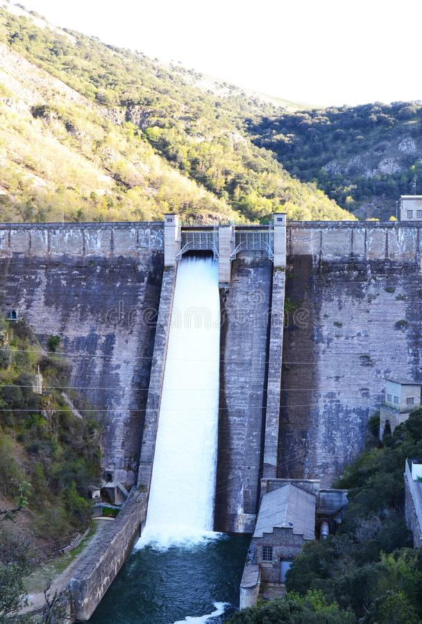 Water fall in the mansilla reservoir and its power plant. stock images