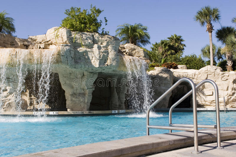 Water Fall in Pool. At a luxury hotel royalty free stock photo