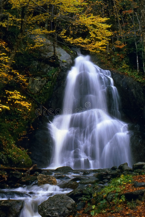 Water Fall in Vermont. This image of the beautiful waterfall surrounded by the fall foilage was taken in central Vermont royalty free stock photo