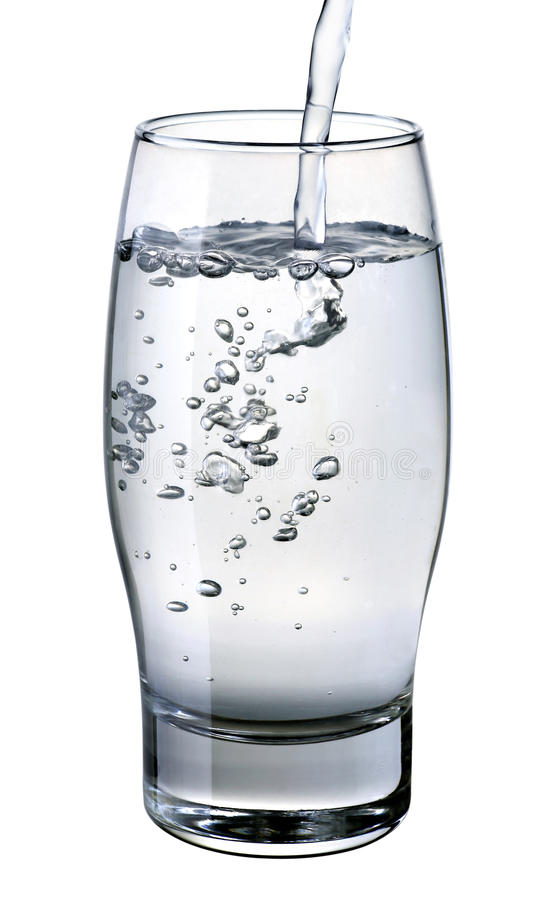 Water falling into glass royalty free stock photos