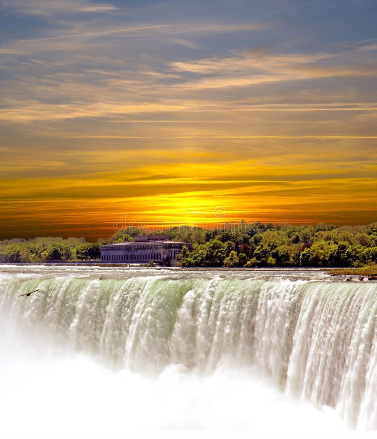 Water falls. With sunset on the background stock photography
