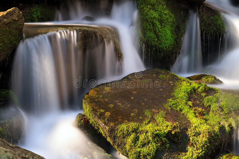 Smoky Mountains Cascade. Water falls over a jumble of moss-covered boulders in Great Smoky Mountains National Park, Tennessee, USA stock image