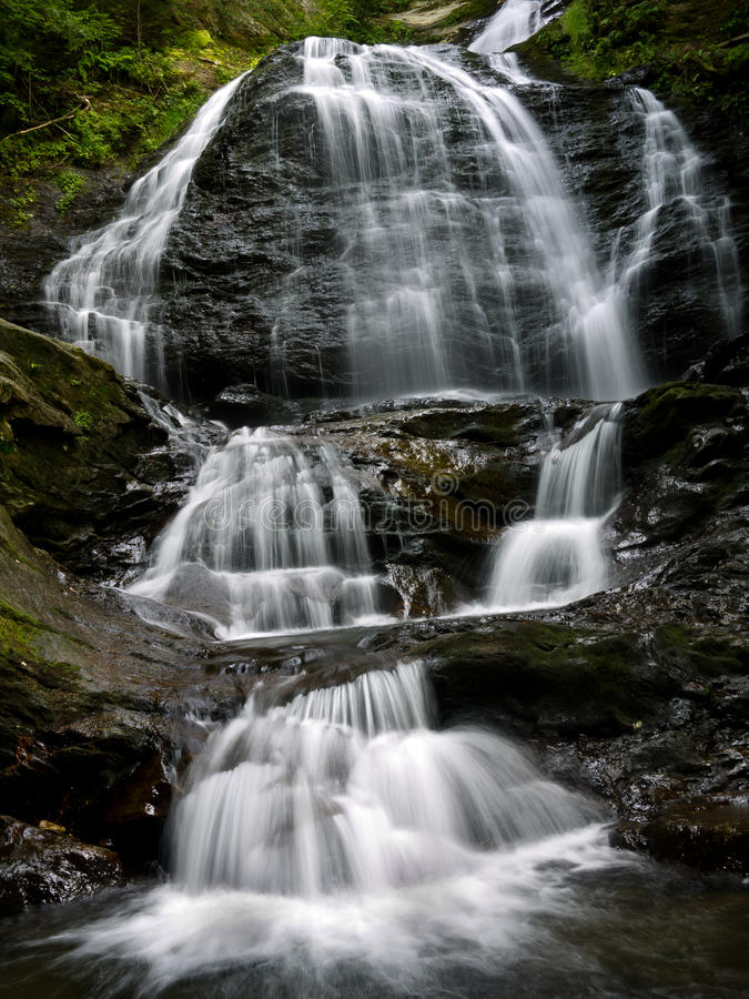 Water Falls, Stowe Vermont. In a deep gorge carved out of solid granite, the cascading water at Moss Glen Falls, Stowe, Vermont stock photography
