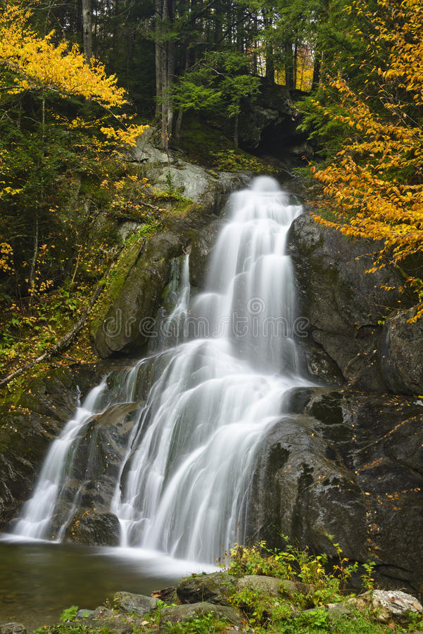 Water Falls surrounded by Autumn Color royalty free stock image