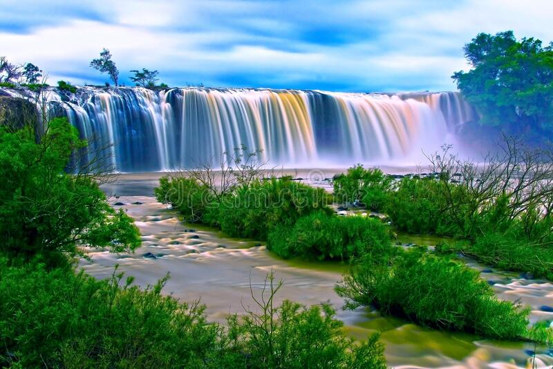 Water Falls Surrounding Green Grass during Daytime stock photography