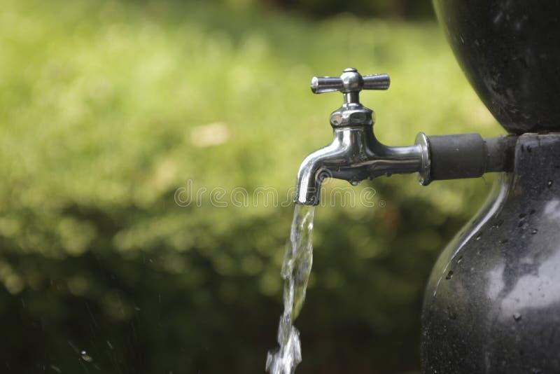 Water. Faucet stock photos
