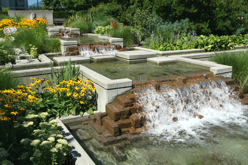 Water Feature. And flower garden royalty free stock image
