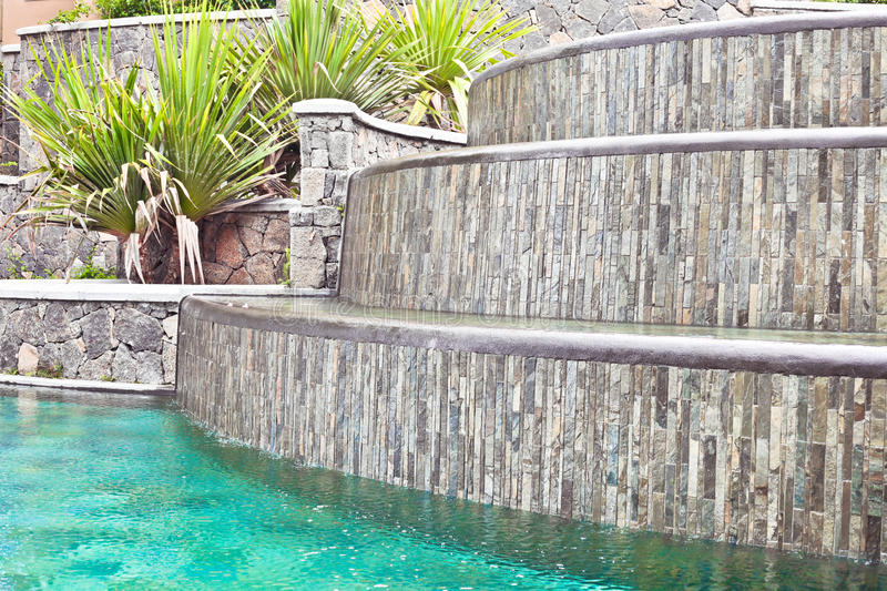 Water feature. A water feature in a tropical landscaped garden stock photos