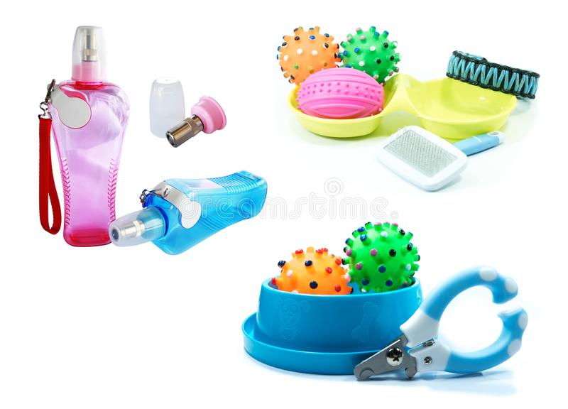 Water feeder, Bowls and rubber toys for pet on white. Background royalty free stock image