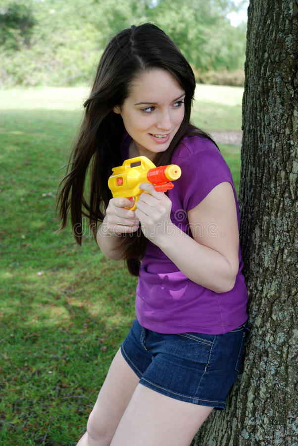 Water fight. Girl having water fight outside royalty free stock photos