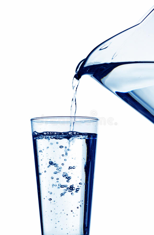 Download Water Is Filled Into A Glass Of Water Stock Photo - Image: 25494676