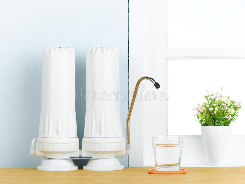 Water filter. Clean and purify drinking by drinking water filter easy and convenience at home stock image