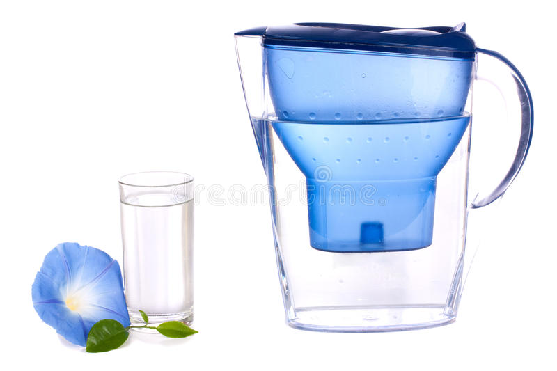 Water filter and a glass. Over white background stock photos