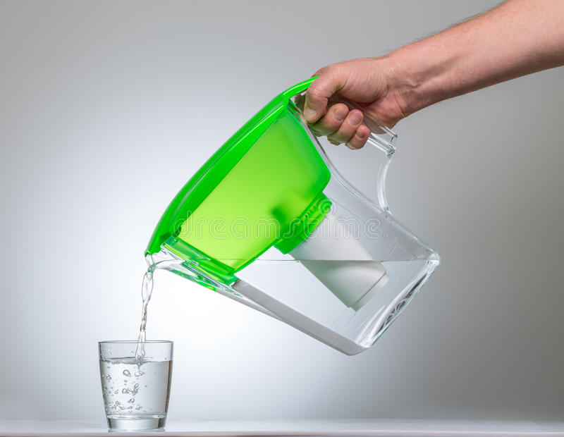 Water Filter Jug. Glass of water and a water filter stock images