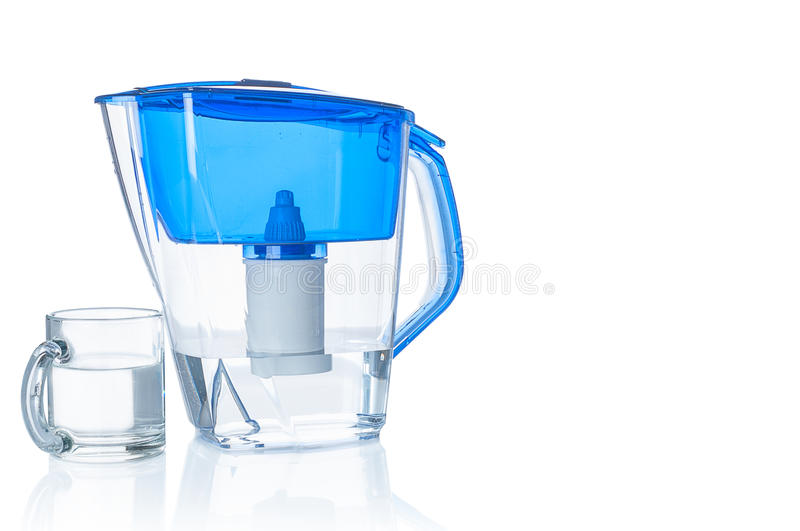 Water filter pitcher and glass. On white background stock photos