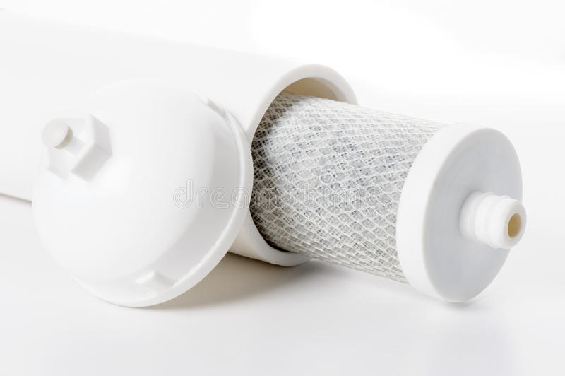Water filter. Used cartridge for water filtration, activated carbon block filter royalty free stock photos